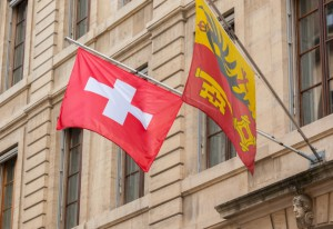 Swiss and Geneva flag floating in the air